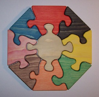 "The pieces of this jigsaw puzzle are light in weight, large in size (about 3/4"" thick for easy handling), and interlock for toddlers to assemble them easily. Size octagon shaped - 11 inches and 3lbs. in weight"