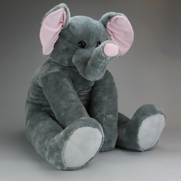 """Derby, the baby elephant stand 42"""" tall, and sure is a big stuffed animal! His plush shiny coat is ever so soft and he has a wonderful face expression!"""