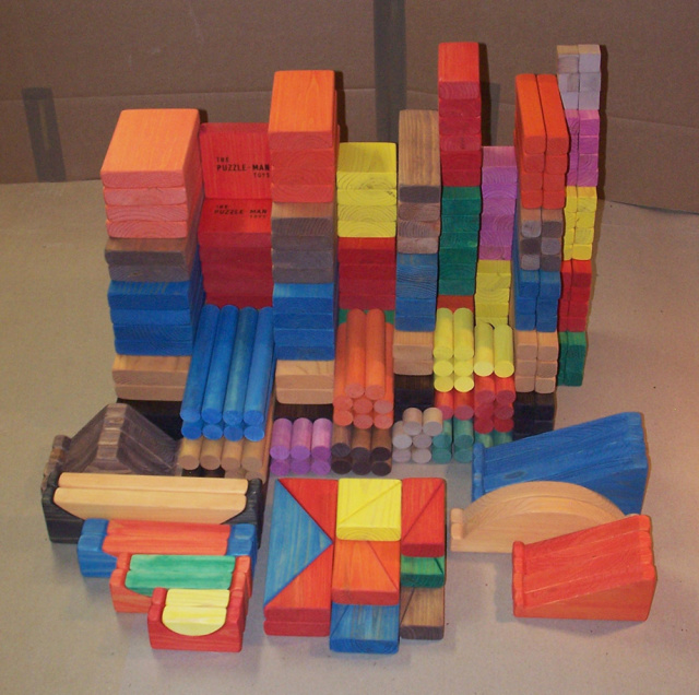 A  set with 280 building block is provides brain development for your child!  These educational games of wooden toys build dexterity; hand-eye coordination, color, shape and size identification and also arithmetical and geometrical relationships become apparent!