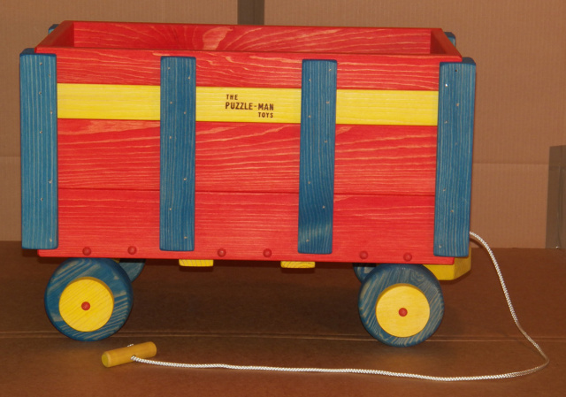 "This wooden wagon size approximately 16"" wide, 26"" long, and 17"" high  can hold a multitude of things your child loves. It is very strong, colorful, sturdy and can have many uses.  All children will love to have wagons like this."